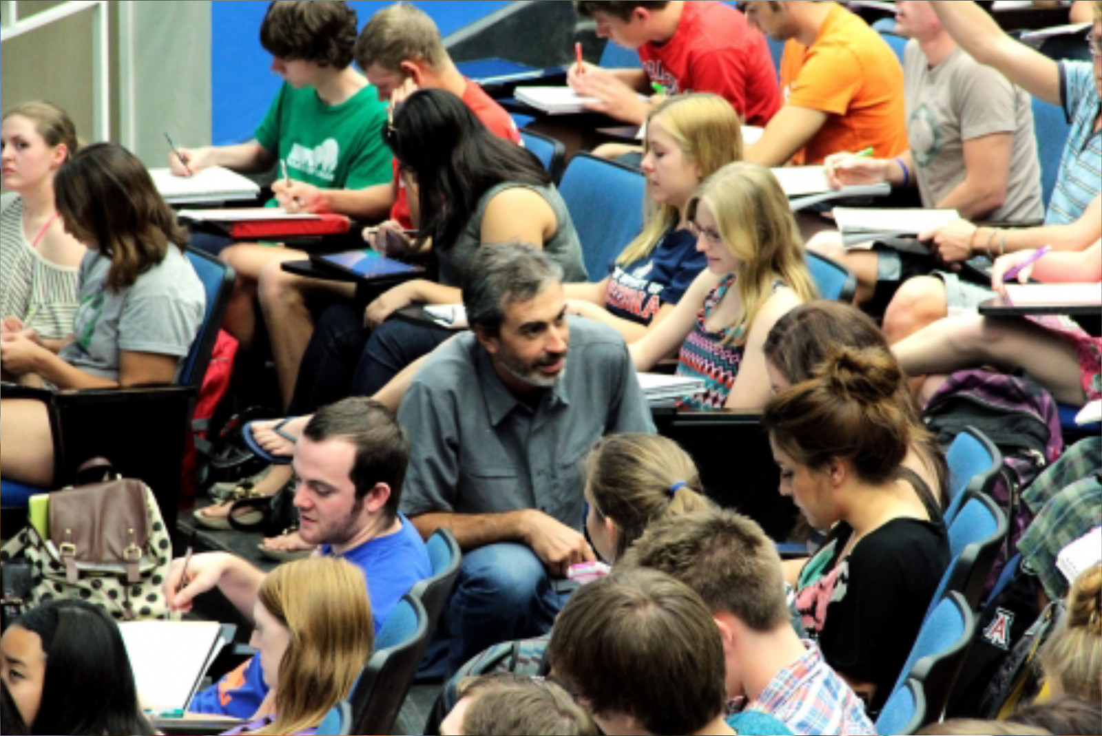 Image of students in  a lecture hall on the campus of the University of Arizona.